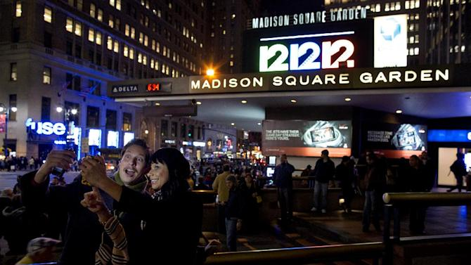 "Friends Steve Ramos, of Los Angeles, and Viviana Barraza, of Bridgeport, Conn., take a photo of themselves before attending the ""12-12-12"" benefit concert at Madison Square Garden in New York Wednesday, Dec. 12, 2012. Music royalty from the Rolling Stones to Kanye West are gathering at Madison Square Garden for a benefit concert to help storm victims. (AP Photo/Craig Ruttle)"