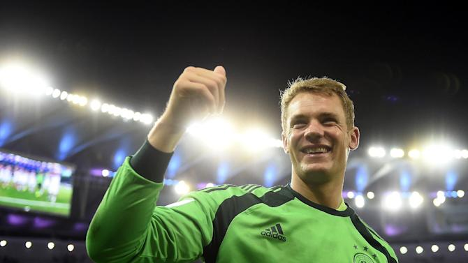 Germany's goalkeeper Manuel Neuer celebrates after winning the 2014 FIFA World Cup final football match between Germany and Argentina 1-0 following extra-time at the Maracana Stadium in Rio de Janeiro, Brazil, on July 13, 2014