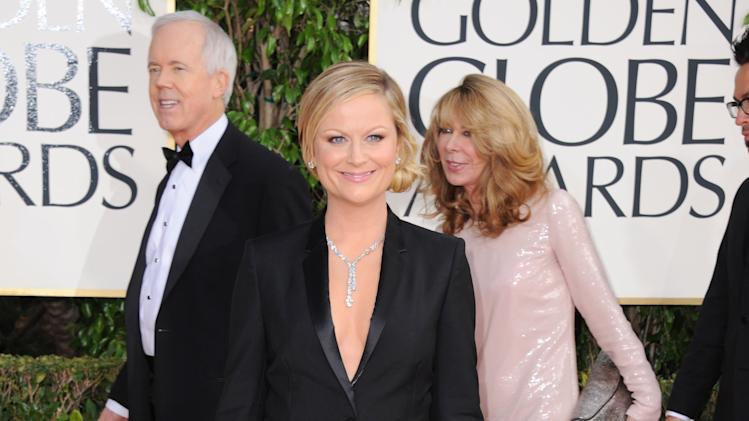 Show host Amy Poehler arrives at the 70th Annual Golden Globe Awards at the Beverly Hilton Hotel on Sunday Jan. 13, 2013, in Beverly Hills, Calif. (Photo by Jordan Strauss/Invision/AP)