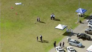 In this image taken from video and provided by WABC-TV in New York, investigators stand near a remote controlled toy helicopter, center, that apparently struck and killed a 19-year-old man, top left, Thursday, Sept. 5, 2013, at Calvert Vaux Park in the Brooklyn borough of New York. It wasn't immediately clear how the accident occurred and police didn't immediately say if the man was operating the remote control helicopter he was struck by. (AP Photo/WABC-TV) MANDATORY CREDIT, NO SALES