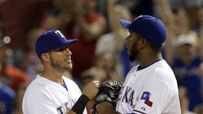 Rangers use record 31st pitcher, beat A's 4-1