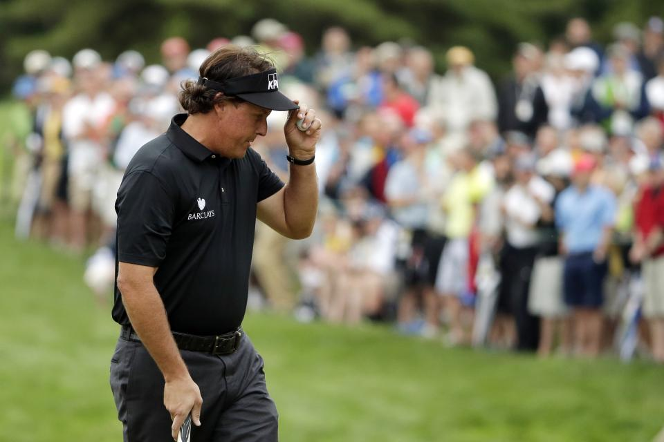 Phil Mickelson tips his hat on the 12th green during the first round of the U.S. Open golf tournament at Merion Golf Club, Thursday, June 13, 2013, in Ardmore, Pa. (AP Photo/Charlie Riedel)