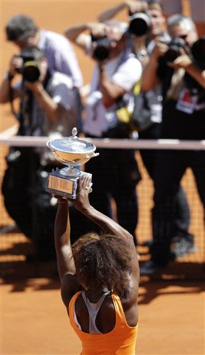 Serena Williams, of the United States, poses with the trophy after winning her final match against Belarus' Victoria Azarenka at the Italian Open tennis tournament in Rome, Sunday, May 19, 2013. Seren