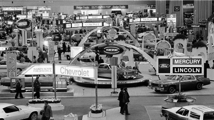 FILE - In this Jan. 15, 1975 file photo, crowds visit the 59th Detroit Auto Show in the Cobo Arena in Detroit. Hundreds of thousands of buyers and car fans are expected to crowd Detroit's North American International Auto Show from Jan. 14-27, 2013. Some 800,000 visitors are expected to descend on the city's 18-acre Cobo Center, where more than 500 cars and trucks will be on display. (AP Photo/File)
