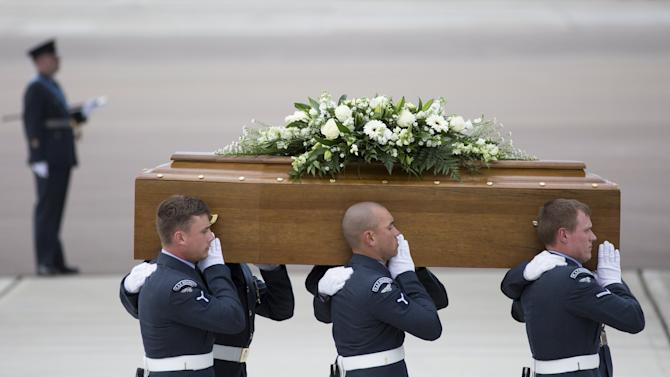The coffin of John Stocker is carried from an RAF C-17, which repatriated the bodies of nine British nationals killed by a gunman in an attack at the Tunisian beach resort of Sousse, in RAF Brize Norton