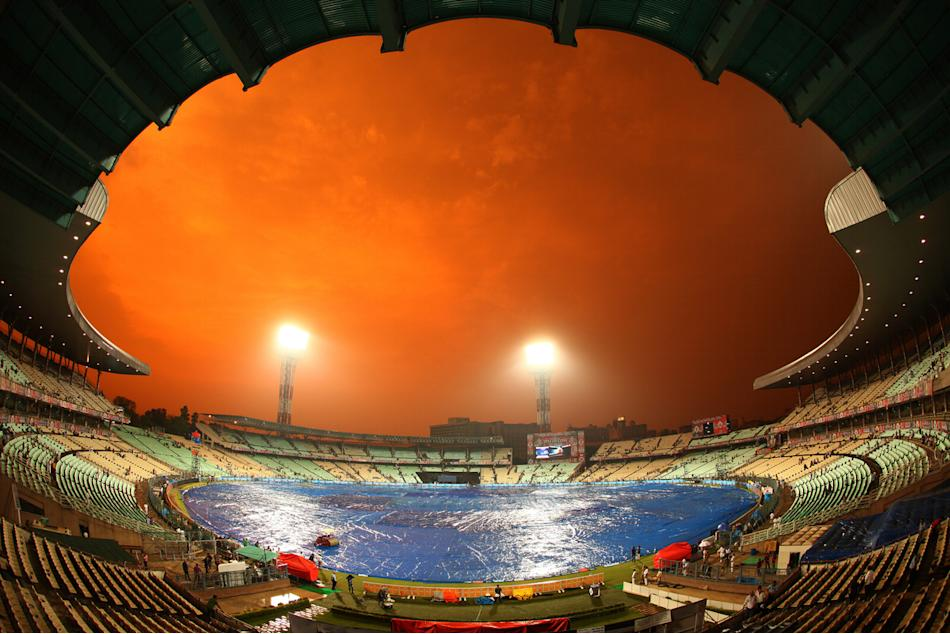 The sun sets as the rain falls over Eden gardens during the 2nd Qualifying match of the Pepsi Indian Premier League between The Rajasthan Royals and the Mumbai Indians  held at the Eden Gardens Stadiu