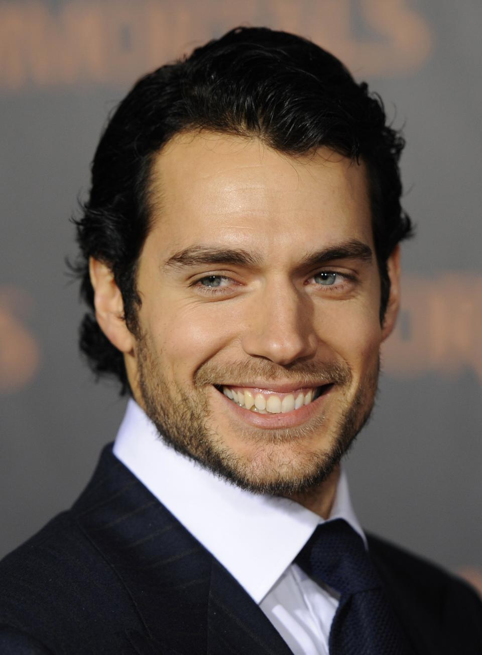 "In this Nov. 7, 2011 photo, actor Henry Cavill, a cast member in ""Immortals,"" poses at the premiere of the film in Los Angeles. The film will be released on Friday. (AP Photo/Chris Pizzello, file)"