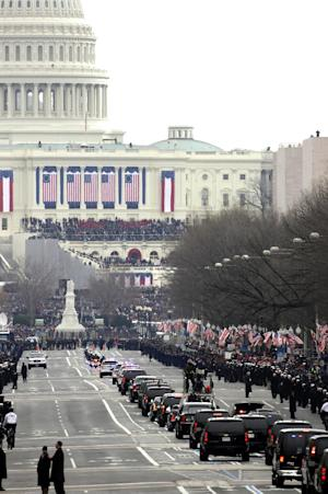 The motorcade of President Barack Obama heads up Pennsylvania Avenue to the U.S. Capitol for the 57th Presidential Inaugural, Monday, Jan. 21, 2013 in Washington. (AP Photo/Alex Brandon)