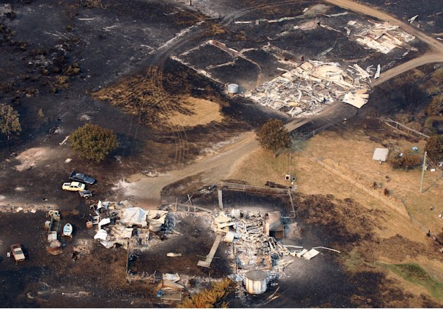 This aerial photo shows homes destroyed by a wildfire between Dunalley and Boomer Bay, east of the Tasmanian capital of Hobart, Australia, on Saturday, Jan. 5, 2013.   Australian officials battled a s