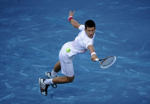 Serb Novak Djokovic returns a shot to Serb Janko Tipsarevic