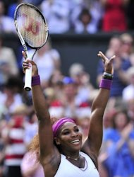 US player Serena Williams celebrates her women's singles semi-final victory over Belarus's Victoria Azarenka on day 10 of the 2012 Wimbledon Championships tennis tournament at the All England Tennis Club in Wimbledon, southwest London