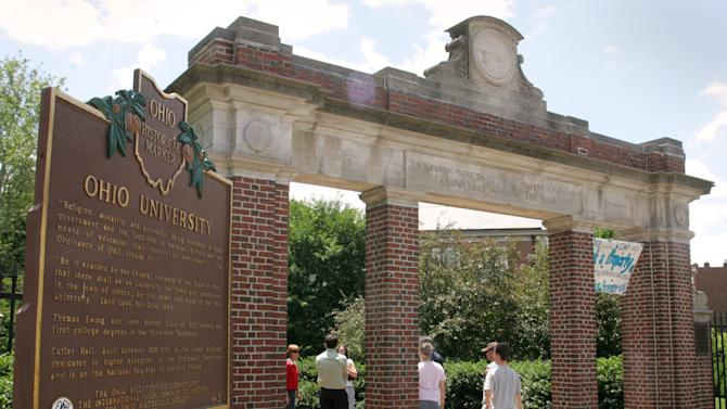 In this June 12, 2006 file photo, a gate with a historic marker is shown on the Ohio University campus in Athens, Ohio. Ohio University, set in an Appalachian town known for its rowdy Halloween bashes, has been named the nation's No. 1 party school, pushing the University of Georgia down a slot in the 2011 Princeton Review survey released Monday, Aug. 1, 2011. (AP Photo/Joe Maiorana, File)