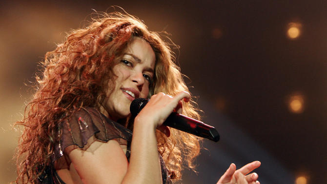 """FILE - In this Jan. 25, 2007 file photo, Colombian singer Shakira performs during the German opening concert of her  """" Oral Fixation Tour"""" in Hamburg, Germany. NBC announced Monday, Sept. 17, 2012 that Usher and Shakira are joining """"The Voice"""" as new coaches next spring, when Christina Aguilera and CeeLo Green take a break from the show. (AP Photo/Fabian Bimmer, File)"""