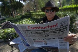 A man reads Cumhuriyet, the leading pro-secular Turkish…