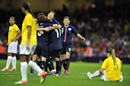 Japan's striker Shinobu Ohno (C) celebrates scoring the second goal with her team-mates during the London 2012 Olympic Games women's quarter-final football match between Brazil women and Japan women at the Millennium Stadium in Cardiff, Wales on August 3, 2012.  AFP PHOTO / GLYN KIRK