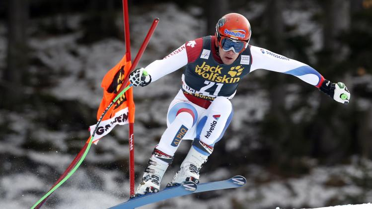 Switzerland's Kueng clears a gate during the second training session of the men's World Cup Downhill skiing race in Val Gardena