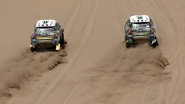 France's Stephane Peterhansel (R) and Spain's Nani Roma drive their Minis during the 12th stage of the Dakar Rally (Reuters)