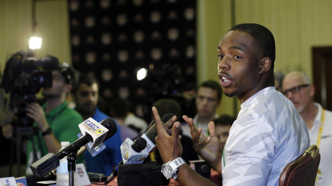Notre Dame running back Theo Riddick, right, gestures as he answers questions during a media availability, Friday, Jan. 4, 2013 in Fort Lauderdale, Fla. Notre Dame is scheduled to play Alabama on Monday, Jan. 7 in the BCS national championship NCAA college football game. (AP Photo/Wilfredo Lee)