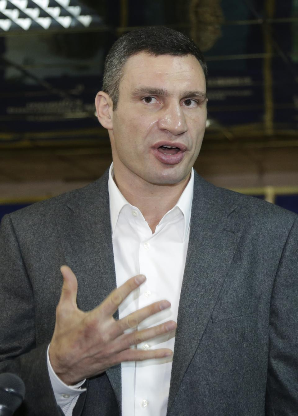 WBC Heavyweight Champion and Chairman of the Ukrainian democratic opposition Ukrainian Democratic Alliance for Reform Party Vitali Klitschko speaks to media after voting at a polling station during parliamentary elections in Kiev, Ukraine, Sunday, Oct. 28, 2012. (AP Photo/Efrem Lukatsky)