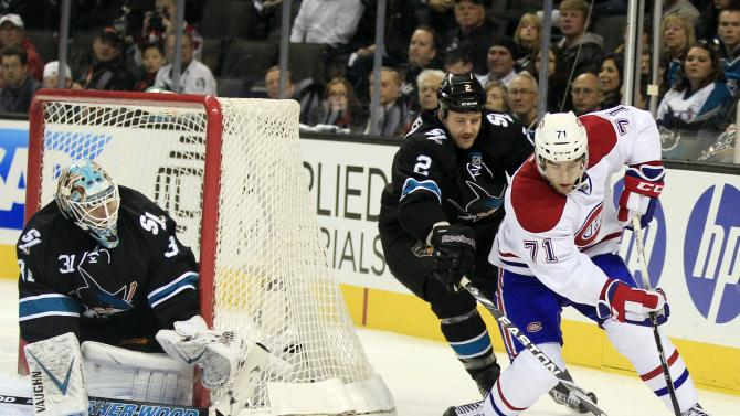Montreal Canadiens center Louis Leblanc, right, tries to get around San Jose Sharks defenseman Jim Vandermeer (2) as goalie Antti Niemi, of Finland, looks on during the first period of an NHL hockey game in San Jose, Calif., Thursday, Dec. 1, 2011.(AP Photo/Marcio Jose Sanchez)