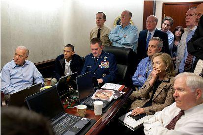 U.S. President Barack Obama and Vice President Joe Biden, along with members of the national security team, receive an update on Operation Geronimo, a mission against Osama bin Laden, in the Situation Room of the White House, May 1, 2011.