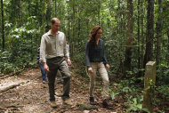 Prince William, left, and his wife Kate, the Duke and Duchess of Cambridge walk through the rainforest in Danum Valley Research Center in Danum Valley, Sabab, Malaysia, Saturday, Sept. 15, 2012. (AP Photo/ Vincent Thian, Pool)