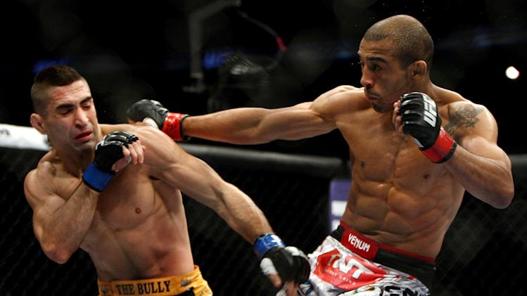 Jose Aldo, right, of Brazil and Ricardo Lamas of Chicago, IL fight in the second round of the Ultimate Fighting Featherweight Championship Mix Martial Arts bout in Newark, N.J. on Saturday, Feb. 1, 2014. Aldo won by unanimous decision in five rounds