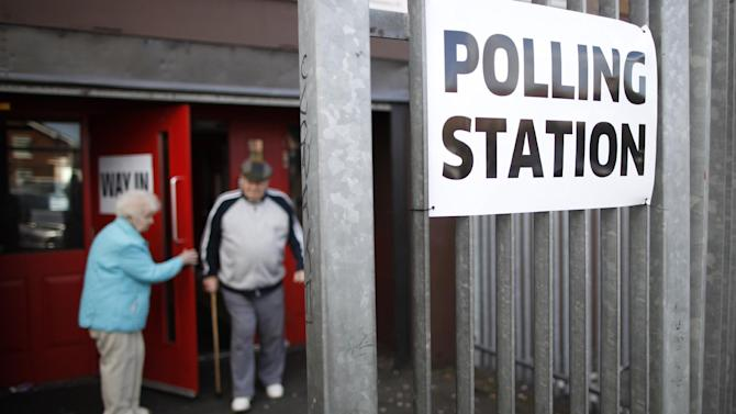 FILE - In this Thursday, May 7, 2015 file photo, voters leave a polling station in the Clonard area of West Belfast, Northern Ireland. These are tough times for political pollsters. In recent elections in Israel, Britain and Poland pre-election polls failed spectacularly to predict election results, sending shock waves through entire nations on election night. Now many research pollsters are analyzing these fiascos in search of ways to do better in the future. In Britain, Prime Minister David Cameron's Conservatives won a clear victory on May 7 after polls had predicted a near tie with Labour, generating expectations of a hung parliament. A day after the election the British Polling Council launched an independent inquiry into the polls' inaccuracies. (AP Photo/Peter Morrison, File)
