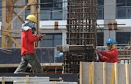 <p>Construction workers are seen at a high-rise building construction site in Manila. As a Philippine property boom gathers pace, even Paris Hilton, Donald Trump and high-fashion house Versace are getting a piece of the action.</p>