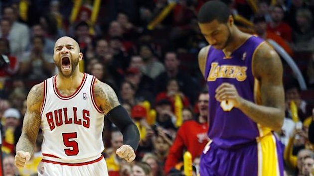 Chicago Bulls power forward Carlos Boozer reacts after a missed shot by the Los Angeles Lakers small forward Earl Clark (Reuters)