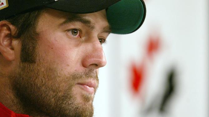 In this Aug. 15, 2005, file photo, Todd Bertuzzi of the Vancouver Canucks speaks to the media on the first day of training camp for the Canadian Men's Olympic Hockey Team in Vancouver. A settlement has been reached in Steve Moore's lawsuit against Bertuzzi for his career-ending hit during an NHL game 10 years ago