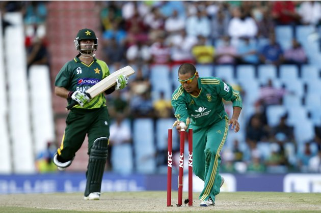 South Africa's Ontong runs out out Pakistan's Shahzad during their Twenty20 cricket match in Pretoria
