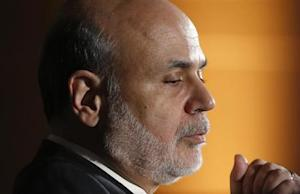 Bernanke speaks during an onstage interview at the National Economists Club annual dinner at the U.S. Chamber of Commerce in Washington
