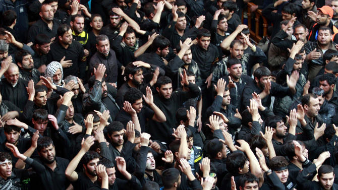 Shiite Muslim worshippers beat themselves inside the holy shrine of Imam Hussein to mark the Muslim festival of Arbaeen in Karbala, 50 miles (80 kilometers) south of Baghdad, Iraq, Thursday, Jan. 3 , 2013. The holiday marks the end of the forty day mourning period after the anniversary of the 7th century martyrdom of Imam Hussein, the Prophet Muhammad's grandson. (AP Photo/ Hadi Mizban)