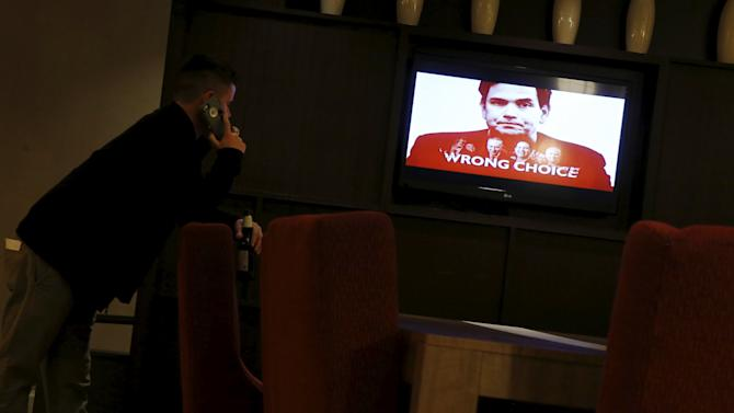A political ad against Rubio plays on a television in a hotel bar in Columbia, South Carolina