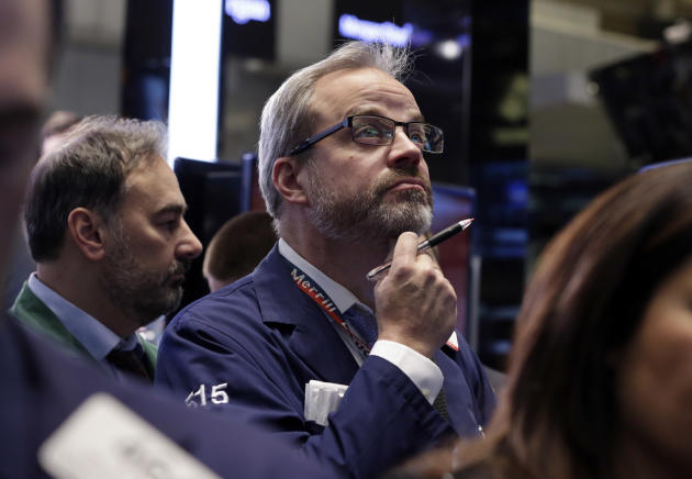Trader David O'Day works on the floor of the New York Stock Exchange Friday, March 7, 2014. Stocks were wavering between small gains and losses early Friday after the government reported a pickup