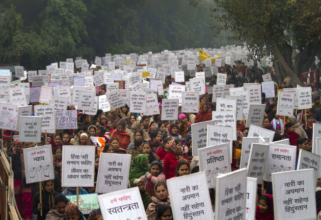 Indian women carry placards as they march to mourn the death of a gang rape victim in New Delhi, India, Wednesday, Jan. 2, 2013. India's top court says it will decide whether to suspend lawmakers faci