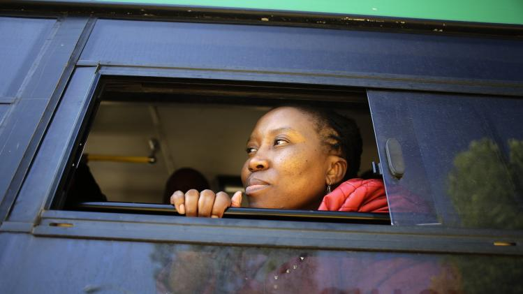 A woman looks out from a bus that arrived at the Union Buildings in Pretoria