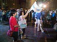 Reform Party volunteers were giving out flyers and flags during the rally. (Yahoo! photo/Alvin Ho)