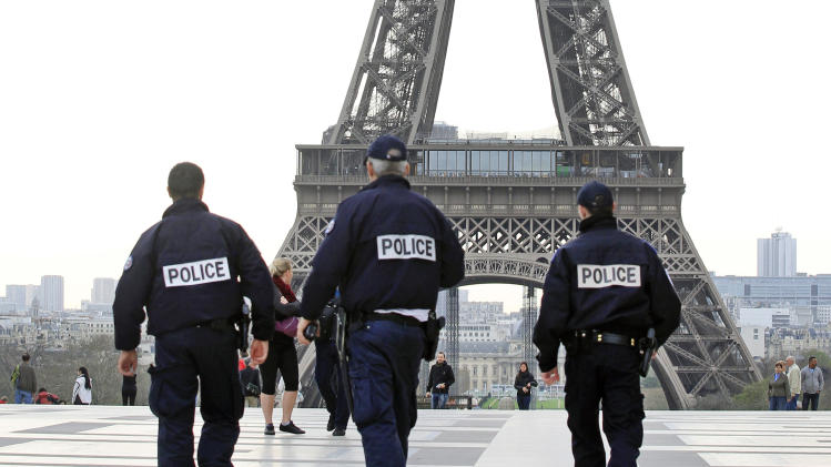 French police officers patrol at the Human Rights Square, near the Eiffel Tower, Paris, Tuesday April 16, 2013. In the wake of the Boston attacks, the French Interior Ministry has ordered local authorities across France to immediately reinforce security measures already in place since the January intervention in Mali began. The ministry did not change the threat level. (AP Photo/Remy de la Mauviniere)