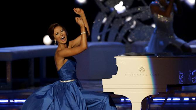Miss Massachusetts Lauren Kuhn plays the piano during the talent portion of the Miss America 2015 pageant, Sunday, Sept. 14, 2014, in Atlantic City, N.J. (AP Photo/Mel Evans)