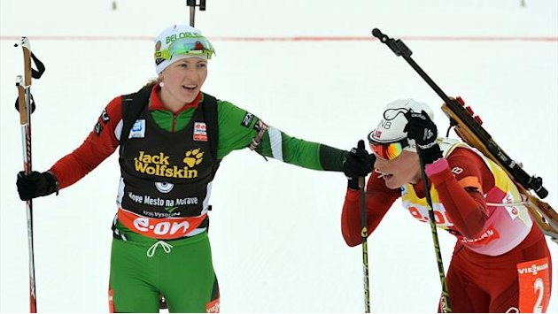 Biathlon - Berger rewrites history books as Domracheva wins gold