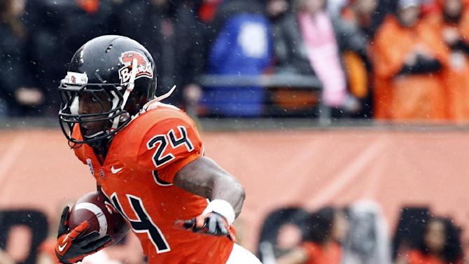 Oregon State running back Storm Woods breaks into the open during the first half of an NCAA college football game against Oregon in Corvallis, Ore., Saturday, Nov. 24, 2012.(AP Photo/Don Ryan)