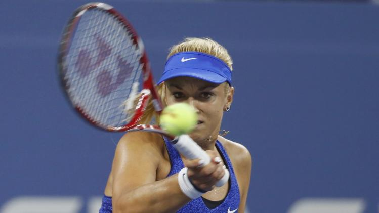Lisicki of Germany returns a shot to Sharapova of Russia during their women's singles match at the U.S. Open tennis tournament in New York