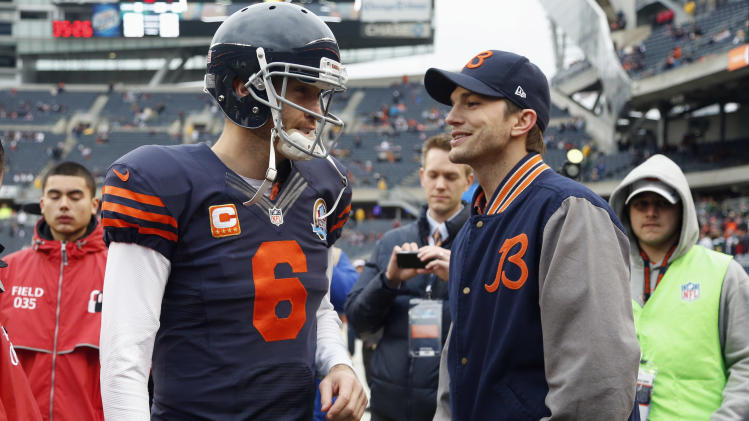 Chicago Bears quarterback Jay Cutler (6) talks actor Ashton Kutcher before an NFL football game in Chicago, Sunday, Dec. 16, 2012. (AP Photo/Nam Y. Huh)