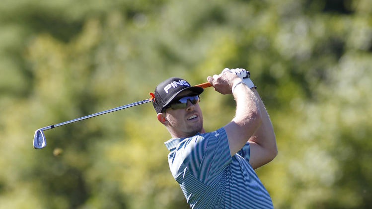 Hunter Mahan hits his second shot on the 10th hole during the first round of the Deutsche Bank Championship golf tournament in Norton, Mass., Friday, Aug. 29, 2014. (AP Photo/Stew Milne)