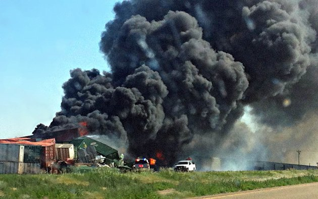 FILE - In this June 24, 2012, file photo, smoke rises from two cargo trains that collided near Goodwell, Okla. The National Transportation Safety Board meeting in Washington on Tuesday, June 18, 2013,