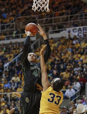 Baylor's Brittney Griner (42) shoots over West Virginia's Ayana Dunning (33) during the first half of an NCAA college basketball game in Morgantown, W.Va., on Saturday, March 2, 2013. (AP Photo/David Smith)