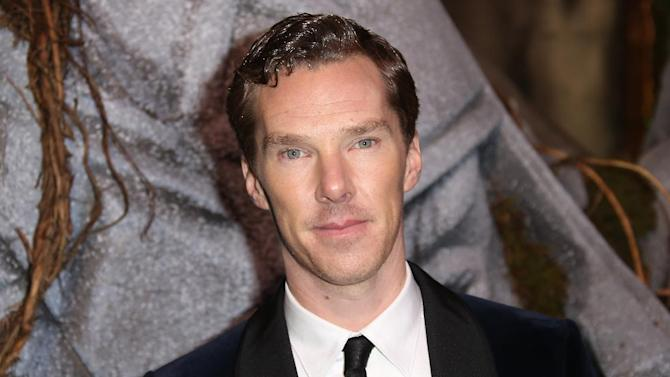 """FILE - In this Monday, Dec. 1, 2014 file photo, actor Benedict Cumberbatch as he poses for photographers upon his arrival at the world premiere of the film The Hobbit, The Battle of the Five Armies in London. Oscar-nominated actor Benedict Cumberbatch has joined others in calling for the British government to pardon gay and bisexual men convicted in the past under the defunct """"gross indecency"""" law. Their letter published Saturday Jan. 31, 2015 in the Guardian praises the government for the 2013 pardon of World War II code breaker Alan Turing, whom Cumberbatch portrays in the movie """"The Imitation Game."""" (Photo by Joel Ryan/Invision/AP, File)"""