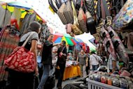 Shoppers browse stalls at Namdaemun market in Seoul. South Korea on Monday unveiled new stimulus measures worth $5.2 billion to boost domestic demand as its export-driven economy struggles with the global economic downturn